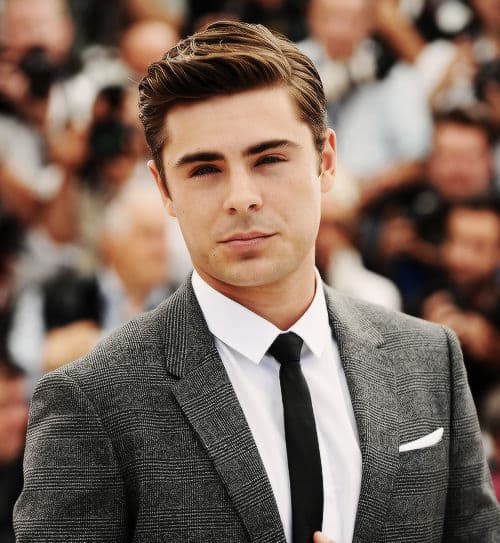 Pic of Zac Efron slick back hair.