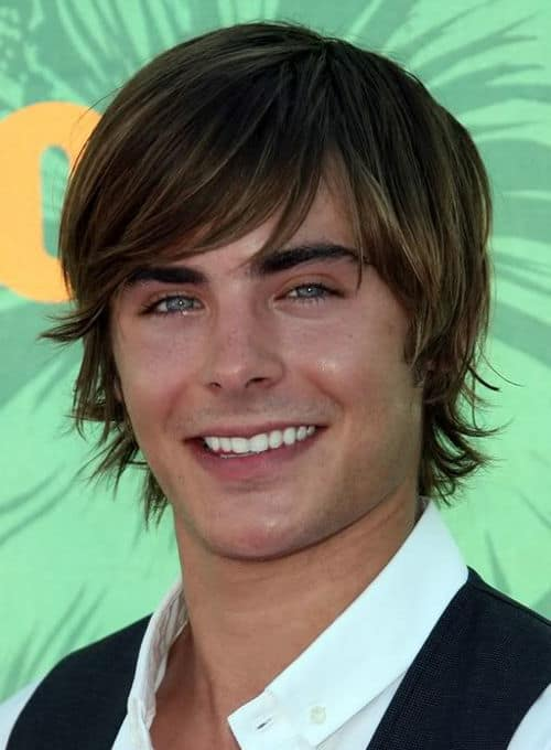 Picture of Zac Efron floppy shag hairstyle.