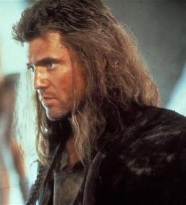 Photo of Mel Gibson long hair in Mad Max.